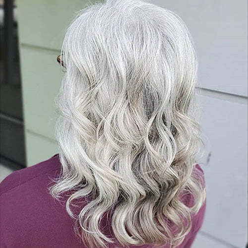 Wavy long hairstyles for older women with gray hair