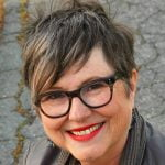 Short hairstyles for women over 50 with glasses in 2021-2022
